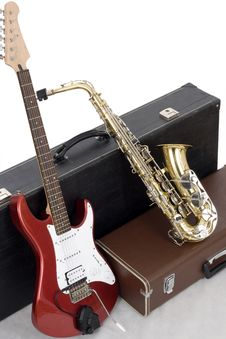 Red Electric Guitar And Gold Sax Stock Photos