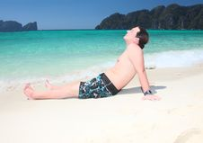Free Young  Man Relaxing On The Beach. Stock Photography - 13915212