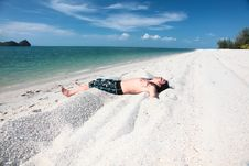 Free Young Man Relaxing On The Beach. Stock Image - 13915281