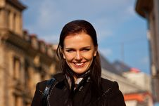Free Smiling Girl In Black Coat In City Background Stock Photos - 13915373