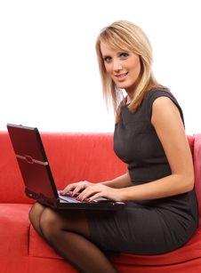 Free Woman Using Laptop On Sofa Royalty Free Stock Image - 13915426