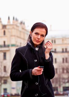 Free Smiling Girl In Black Coat With Headphones Royalty Free Stock Photo - 13915665
