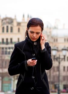 Free Smiling Girl In Black Coat With Headphones Royalty Free Stock Photo - 13915675