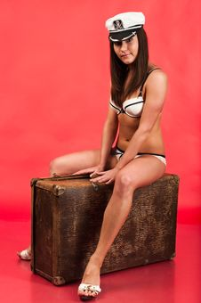 Sexy Girl On Suitcase Royalty Free Stock Images
