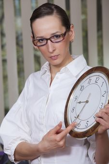 Free Unhappy Woman With Big Clock Stock Images - 13917424