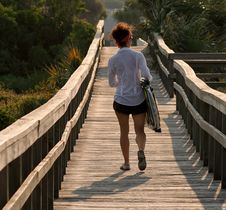 Free Woman Walking On Footbridge Stock Photography - 13918572