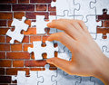 Free Hand With Stucco Puzzle Pieces Stock Photos - 13927933