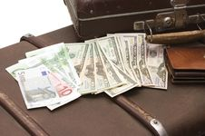 Free Money Lays On An Old Suitcase Stock Photos - 13921273