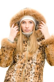 Free The Girl In A Fur Coat Isolated Over White Royalty Free Stock Photography - 13922477