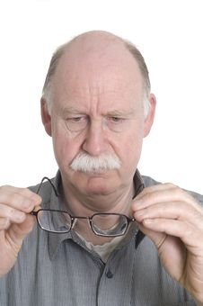 Free Man Looking At Glasses Stock Photo - 13924090