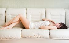 Young Girl Is Lying On A Bed Stock Image