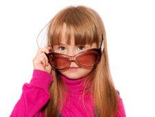 Free Little Girl Looks Over Dark Glasses Royalty Free Stock Images - 13927929