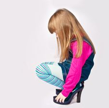 Little Girl In Adult Shoes Royalty Free Stock Photos