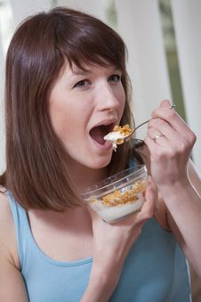 Free Woman Eating Corn Flakes Royalty Free Stock Photo - 13928255