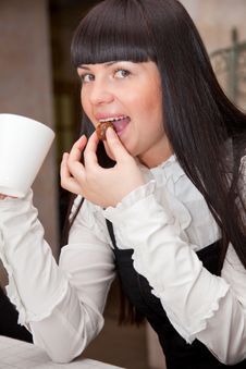 Free Young Girl In Cafe Is Drinking Coffee Royalty Free Stock Photos - 13928578