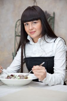 Free Woman Eating In Restaurant Royalty Free Stock Image - 13928666