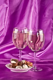 Two Glasses Of White Wine And Sweet Royalty Free Stock Images