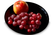 Free Fruit On A Black Plate Stock Images - 13930144