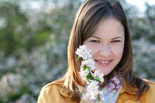Young Woman In Blooming Park Royalty Free Stock Images