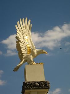 Eagle On A Pedestal And A Bird In A Skay Royalty Free Stock Photos
