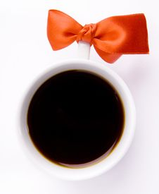 Free White Cup Of Coffee With A Red Bow Royalty Free Stock Photo - 13939185
