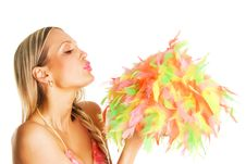 Free Pretty Girl Blowing On Colorful Feathers Stock Photos - 13939213