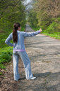 Free Girl Hitch Hiking Near A Forest Road Stock Photos - 13942193