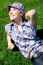 Free Young Caucasian Girl Sitting On The Green Grass Royalty Free Stock Photo - 13949815