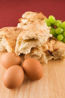 Fresh Bread With Eggs And Grapes Stock Photography