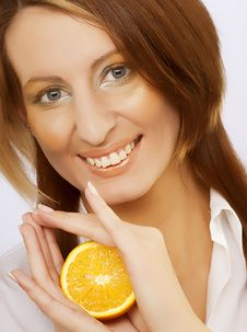Cheerful Woman With Fresh Orange Near Her Face Stock Images
