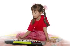 Free The Girl With A Toy Synthesizer Royalty Free Stock Image - 13944526
