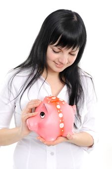 Woman With A Piggy Bank Royalty Free Stock Image