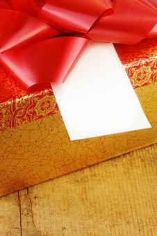 Present With Red Bow And Blank Gift Card Stock Photography