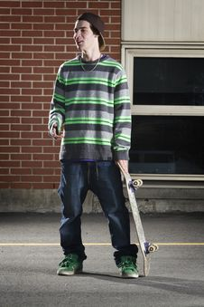 Free Skateboarder Standing With His Board Stock Photos - 13948993