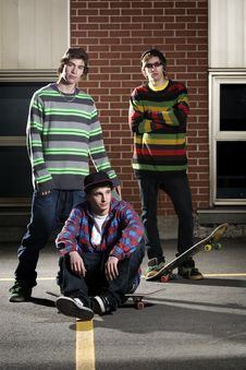 Free Three Skateboarder Friends Standing Together Stock Image - 13949151