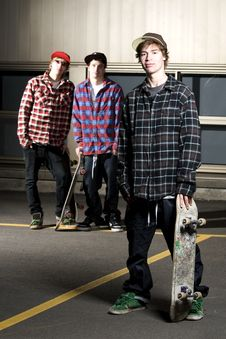 Free Three Skateboarder Kids Standing In Parking Lot Royalty Free Stock Images - 13949229