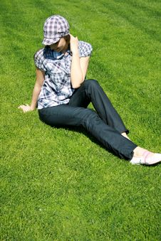 Free Young Girl Sitting On The Grass Royalty Free Stock Images - 13949269