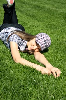 Free Pretty Girl Relaxing On The Grass Stock Image - 13949341