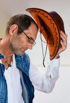Man In Glasses With Cowboy Hat Stock Photography