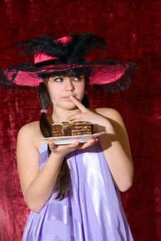 Lovely Girl In Dress And Hat With Cake Stock Photography