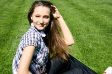 Free Pretty Girl Sitting On The Green Grass Royalty Free Stock Image - 13949826