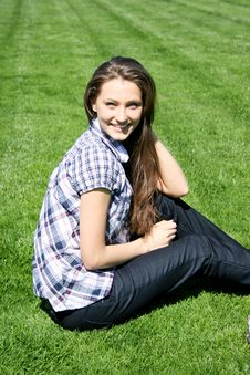 Free Smiling Girl Sitting On The Green Grass Royalty Free Stock Images - 13949839