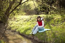 Young Lady In A Forest Stock Photo