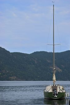 Free Green Sailboat On Calm Water Stock Photo - 13952520