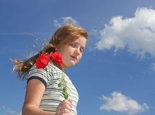 Girl With Poppies Over Sky Stock Photo