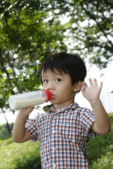 Free Boy With Milk Bottle Stock Image - 13956121
