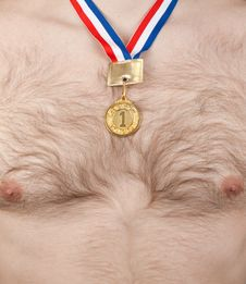 Nude Male Thorax With Hair And Golden Medal Stock Photo