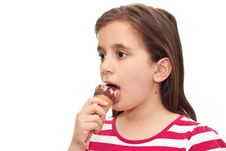 Small Girl Licking An Ice Cream Cone