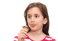Free Small Girl Eating An Ice Cream Cone Stock Images - 13958214