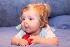 Free Cute Baby Playing Red Toy Stock Photos - 13959313